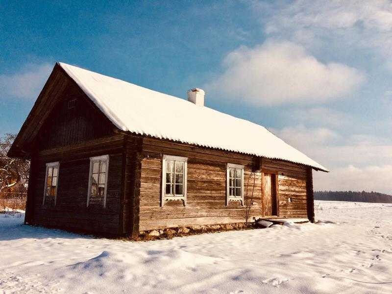 A log house is for sale in Eastern Europe