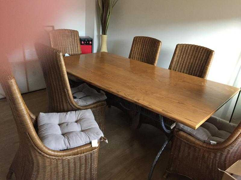 Dining room Table and Six Chairs with matching seat pads from a smoke free and pet free home.