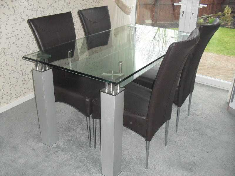 glass table .and four chairs .