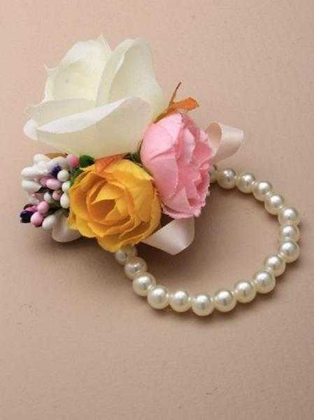 JTY127C - Faux pearl bead stretch wrist corsage with large roses with coloured buds. Cream