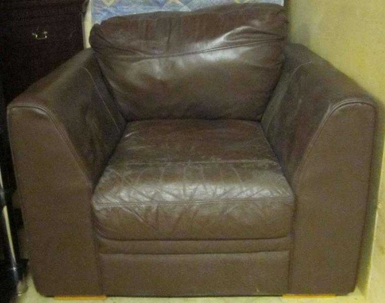 OFFERED FREE   Brown LEATHER ARMCHAIR